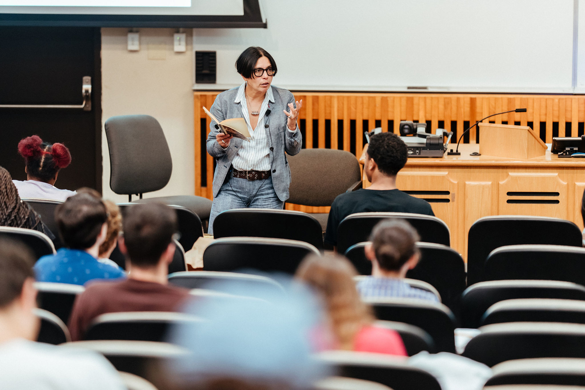 professor lecturing at front of lecture hall