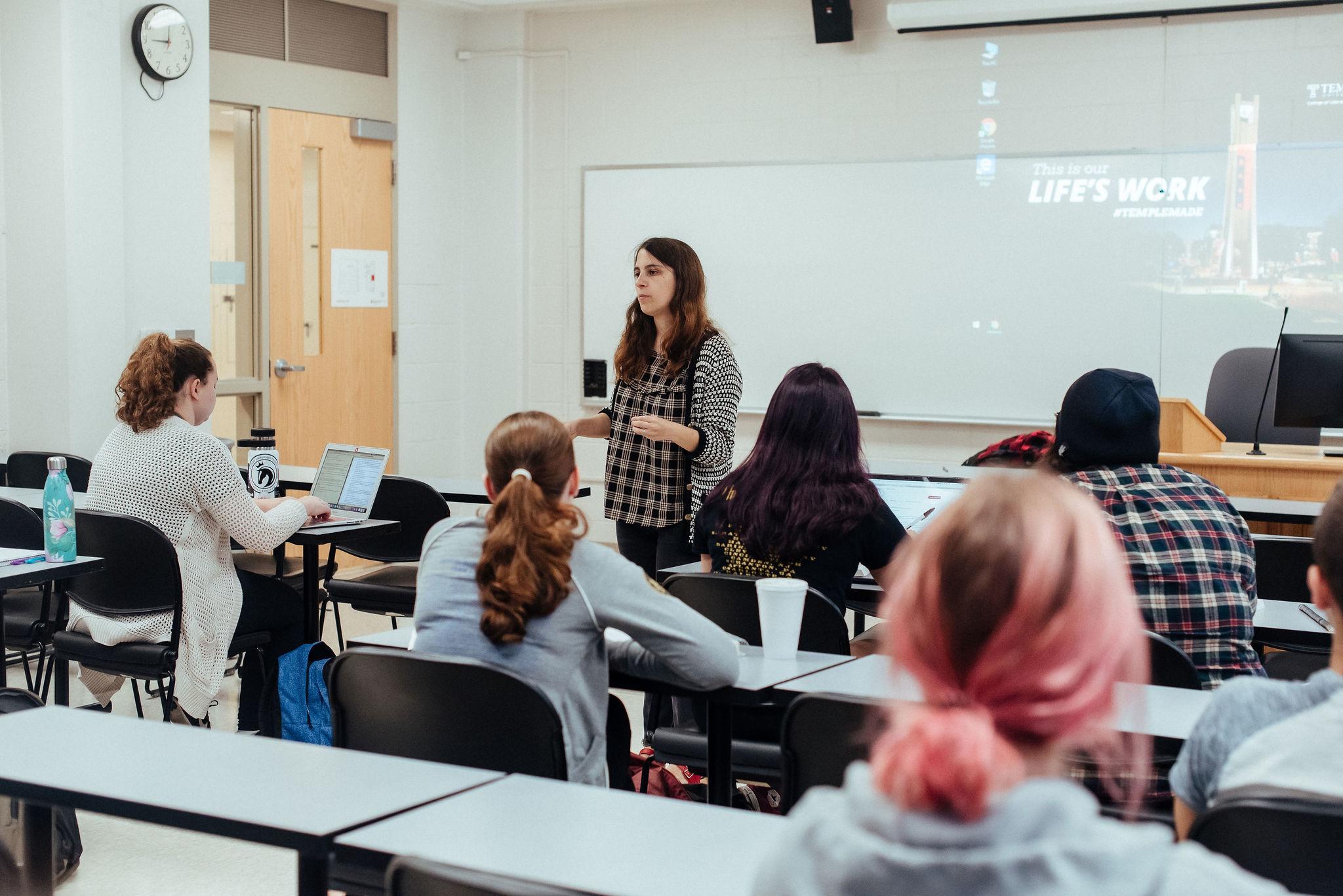 professor lecturing in small class