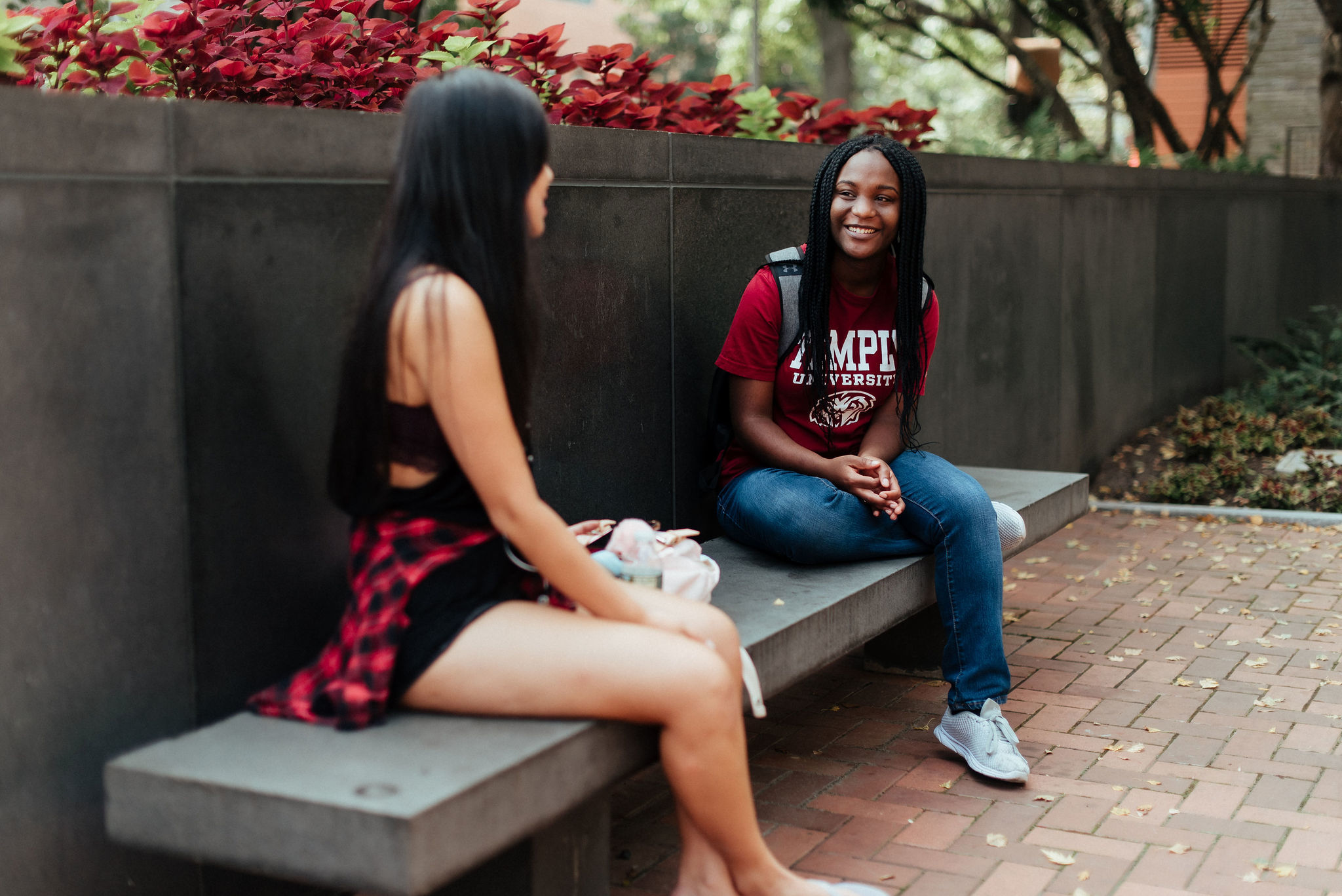 two students talking in founders garden