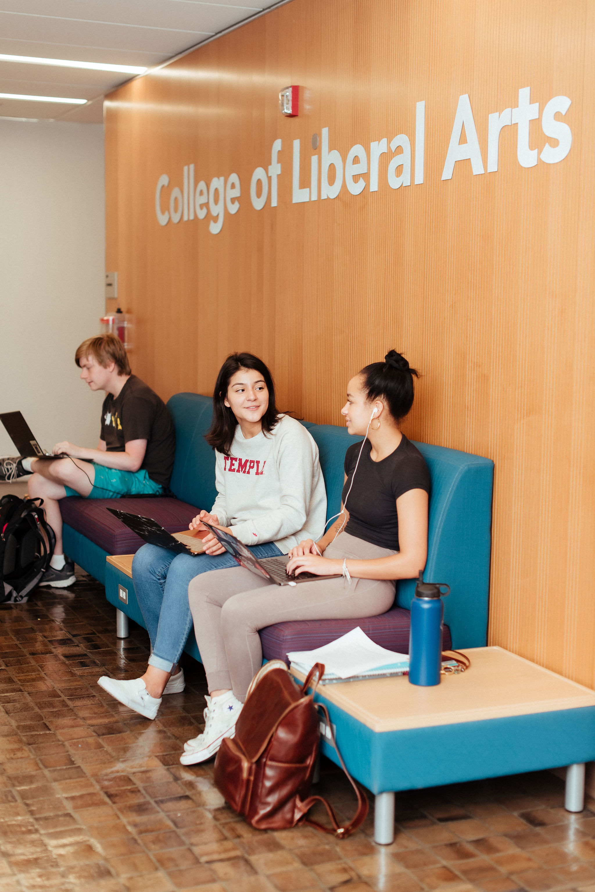 students talking in anderson lobby